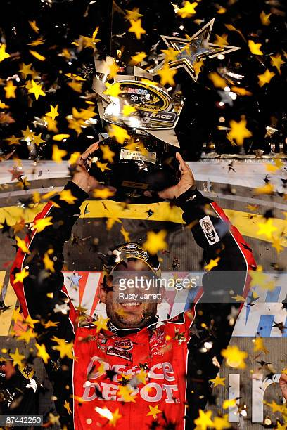 Tony Stewart driver of the Office Depot Chevrolet celebrates in victory lane after winning the NASCAR Sprint AllStar Race on May 16 2009 at Lowe's...
