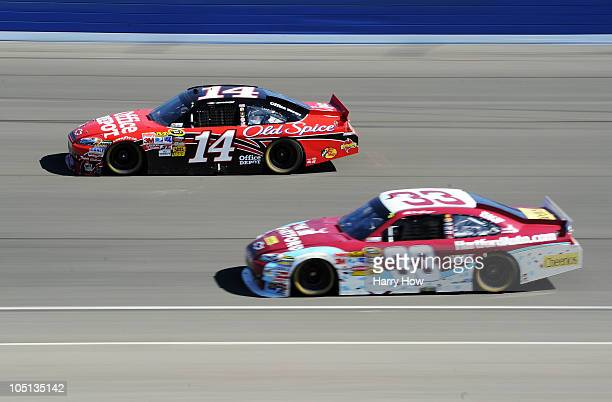 Tony Stewart driver of the Office Depot Chevrolet leads Clint Bowyer driver of the The Hartford Chevrolet during the NASCAR Sprint Cup Series Pepsi...