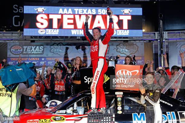 Tony Stewart driver of the Office Depot/Mobil 1 Chevrolet celebrates in victory lane after he won the NASCAR Sprint Cup Series AAA Texas 500 at Texas...