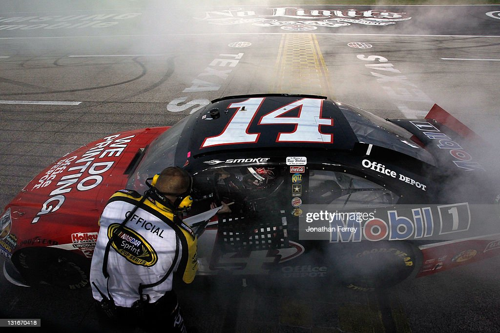 Tony Stewart, driver of the #14 Office Depot/Mobil 1 Chevrolet, celebrates after winning the NASCAR Sprint Cup Series AAA Texas 500 at Texas Motor Speedway on November 6, 2011 in Fort Worth, Texas.