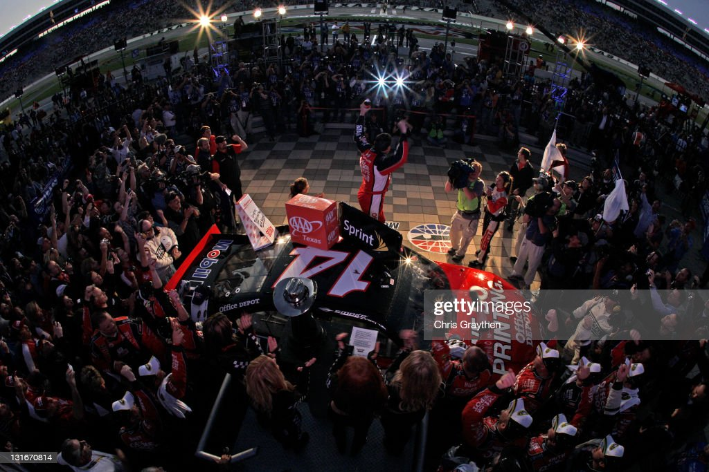 Tony Stewart, driver of the #14 Office Depot/Mobil 1 Chevrolet, celebrates in victory lane after he won the NASCAR Sprint Cup Series AAA Texas 500 at Texas Motor Speedway on November 6, 2011 in Fort Worth, Texas.