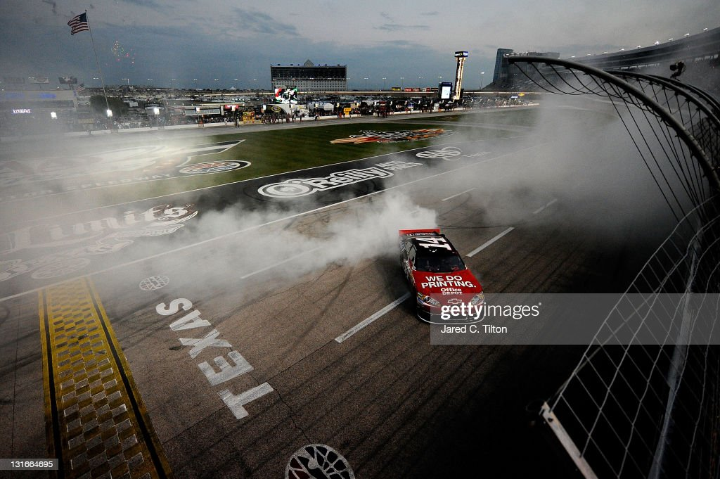 Tony Stewart, driver of the #14 Office Depot/Mobil 1 Chevrolet, performs a burnout in celebration of winning the NASCAR Sprint Cup Series AAA Texas 500 at Texas Motor Speedway on November 6, 2011 in Fort Worth, Texas.
