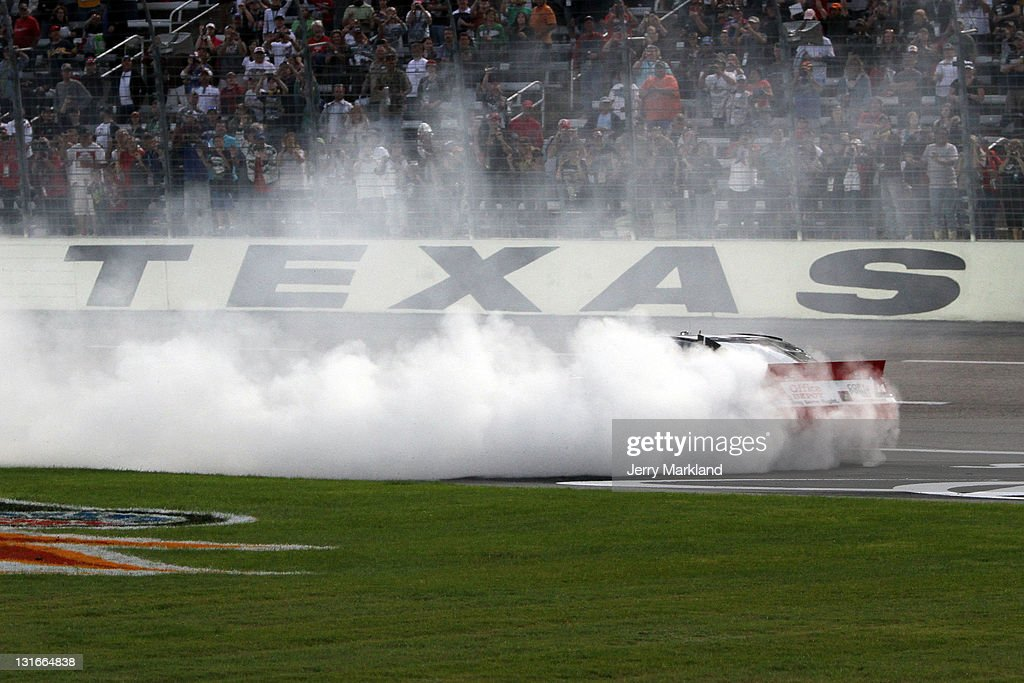 Tony Stewart, driver of the #14 Office Depot/Mobil 1 Chevrolet, performs a burnout in celebration after winning the NASCAR Sprint Cup Series AAA Texas 500 at Texas Motor Speedway on November 6, 2011 in Fort Worth, Texas.
