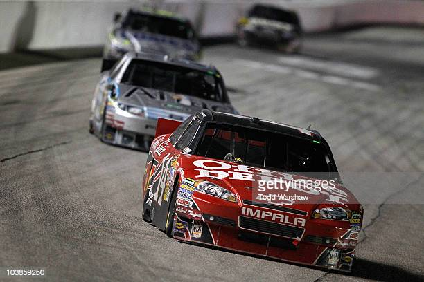 Tony Stewart driver of the Office Depot/Old Spice Chevrolet leads Carl Edwards driver of the Aflac Ford Jimmie Johnson driver of the Lowe's/KOBALT...