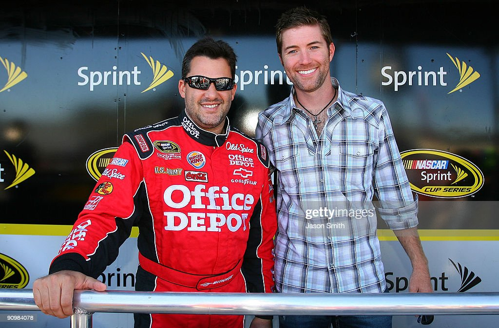 Tony Stewart (L), driver of the #14 Old Spice/Office Depot Chevrolet poses with country music singer Josh Turner (R), prior to the start of the NASCAR Sprint Cup Series Sylvania 300 at the New Hampshire Motor Speedway on September 20, 2009 in Loudon, New Hampshire.