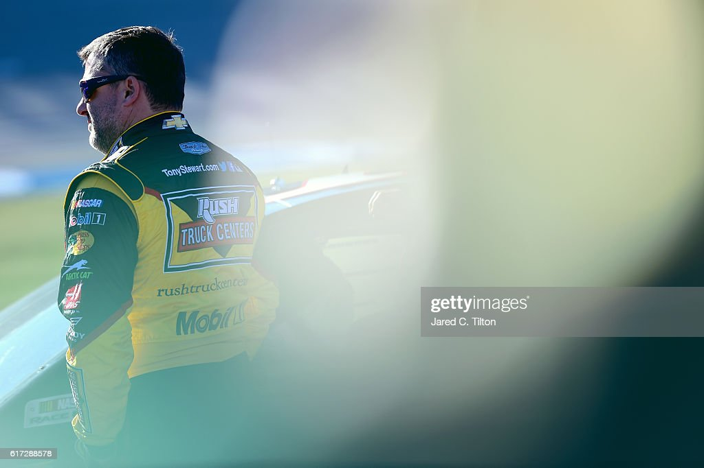 Tony Stewart, driver of the #14 Rush Truck Centers/Mobil 1 Chevrolet, stands on the grid during qualifying for the NASCAR Sprint Cup Series Hellmann's 500 at Talladega Superspeedway on October 22, 2016 in Talladega, Alabama.