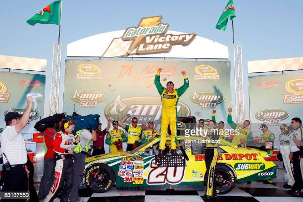 Tony Stewart, driver of the Subway/Home Depot Toyota, celebrates in Victory Lane after winning the NASCAR Sprint Cup Series Amp Energy 500 at...