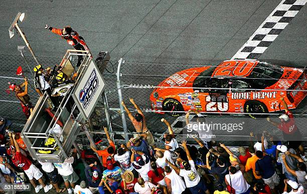 Tony Stewart driver of the The Home Depot Chevrolet celebrates victory during the NASCAR Nextel Cup Series Pepsi 400 on July 2 2005 at Daytona...