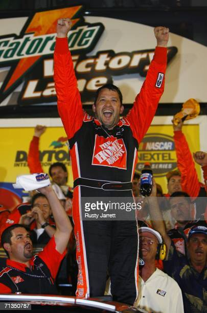 Tony Stewart driver of the The Home Depot Chevrolet celebrates winning the NASCAR Nextel Cup Series Pepsi 400 on July 1 2006 at Daytona International...