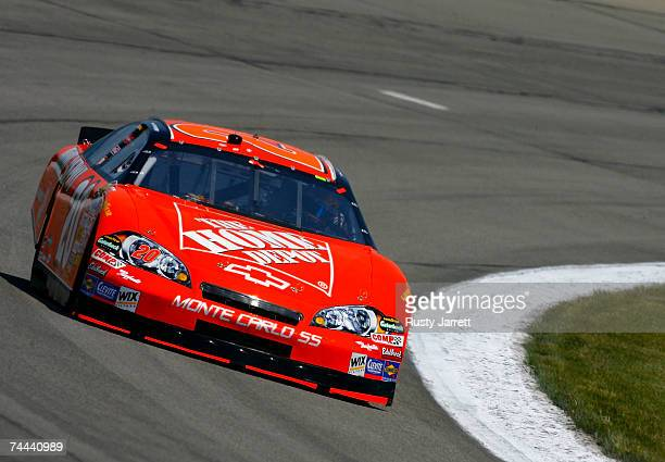 Tony Stewart driver of the The Home Depot Chevrolet races during practice for the NASCAR Nextel Cup Series Pocono 500 at Pocono Raceway on June 8...