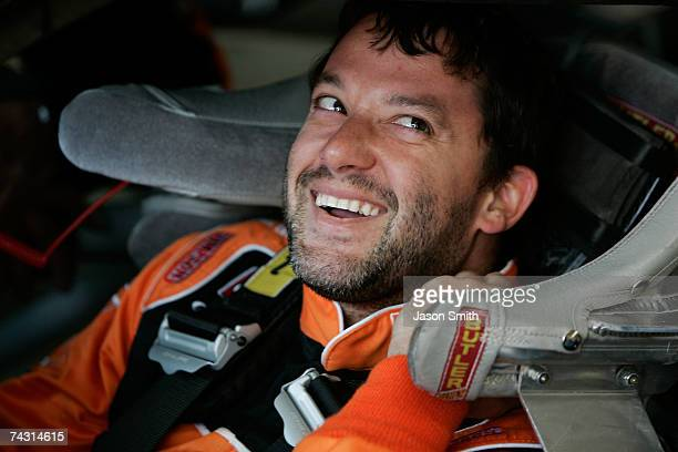 Tony Stewart driver of the The Home Depot Chevrolet smiles while sitting in his car during practice for the NASCAR Nextel Cup Series CocaCola 600 on...