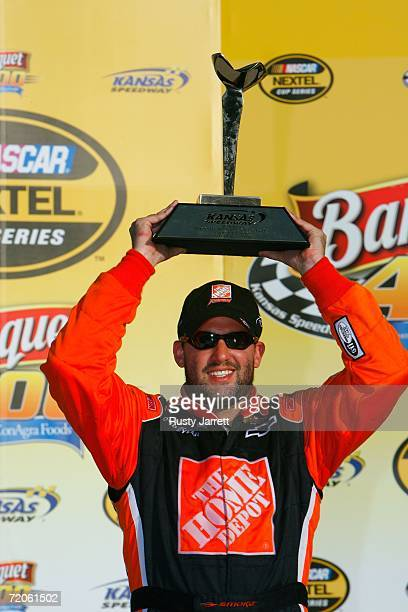 Tony Stewart, driver of the The Home Depot Chevrolet, stands with the winners trophy in victory lane following the NASCAR Nextel Cup Series Banquet...