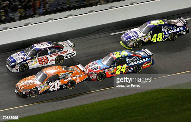 Tony Stewart driver of the The Home Depot Toyota races with Dale Earnhardt Jr driver of the Mountian Dew AMP/National Guard Chevrolet Jeff Gordon...