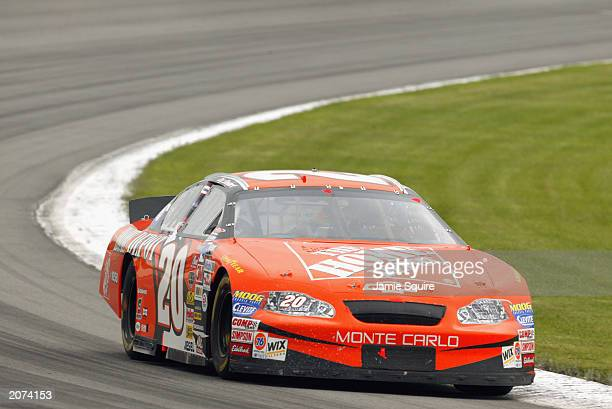 Tony Stewart drives his Joe Gibbs Racing Chevrolet Monte Carlo during the NASCAR Pocono 500 at the Pocono Raceway on June 8 2003 in Long Pond...
