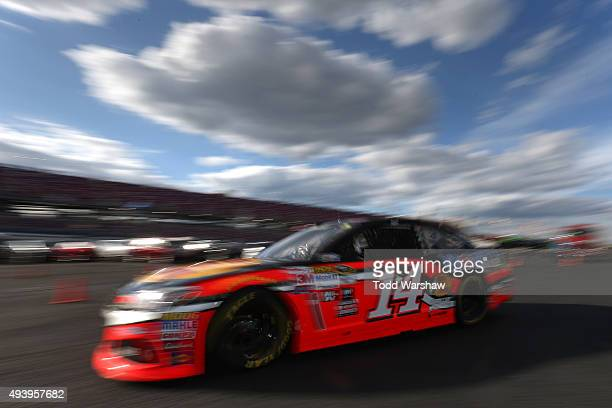 Tony Stewart drives the Bass Pro Shops/Mobil 1 Chevrolet through the garage area during practice for the NASCAR Sprint Cup Series CampingWorldcom 500...