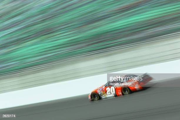 Tony Stewart driving his Joe Gibbs Racing Home Depot Chevrolet on track during practice for the NASCAR Winston Cup Banquet 400 on October 4 2003 at...