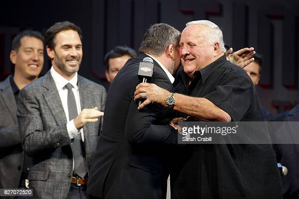 Tony Stewart greets A J Foyt onstage during NASCAR After The Lap at The Pearl concert theater at Palms Casino Resort on December 1 2016 in Las Vegas...