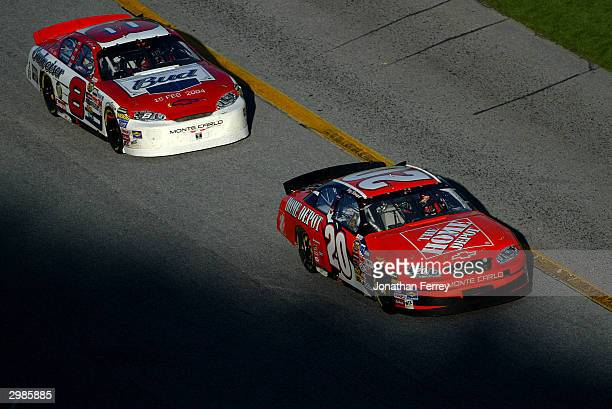 Tony Stewart in his Home Depot Chevrolet battles it out with Dale Earnhardt Jr in his Budweiser Chevrolet during the NASCAR Nextel Cup Daytona 500 on...