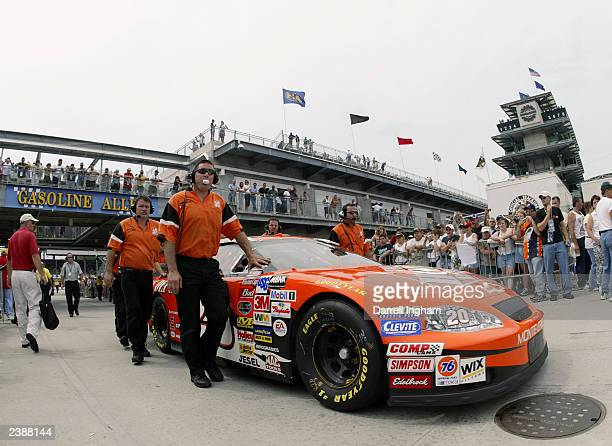 Tony Stewart in the Joe Gibbs Racing Home Depot Chevrolet is pushed through Gasoline Alley during practice for the NASCAR Winston Cup Brickyard 400...