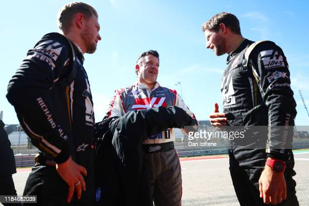 Tony Stewart , Kevin Magnussen of Denmark and Haas F1 and Romain Grosjean of France and Haas F1 talk after driving the No. 14 Haas Automation Ford...