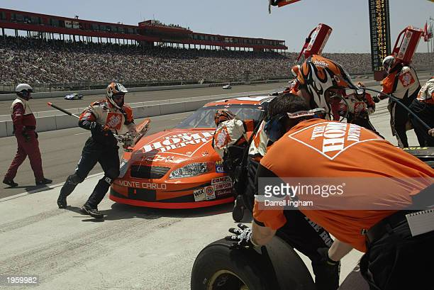 Tony Stewart pits the Joe Gibbs Racing Chevrolet during the NASCAR Winston Cup AUTO CLUB 500 on April 27 2003 at the California Speedway in Fontana...