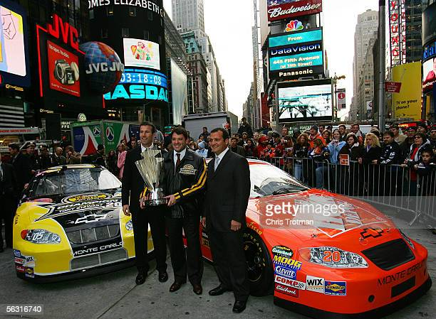 Tony Stewart the 2005 NASCAR Nextel Cup champion poses with team owner JD Gibbs and crew chief Greg Zipadelli with the Nextel Cup in Times Square...