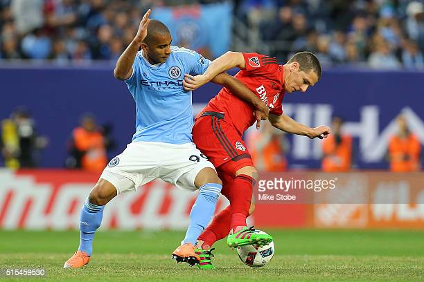 Tony Taylor of New York City FC and Will Johnson of Toronto FC vie for the ball at Yankee Stadium on March 13 2016 in the Bronx borough of New York...
