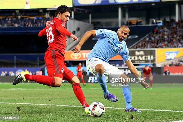 Tony Taylor of New York City FC defends against Marco Delgado of Toronto FC at Yankee Stadium on March 13 2016 in the Bronx borough of New York City