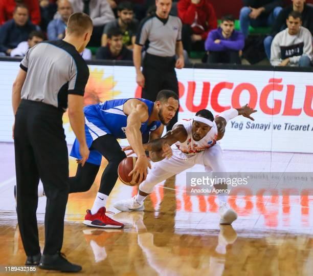 Tony Taylor of Pinar Karsiyaka in action against Davion Barry of Enisey Krasnoyarsk during FIBA Europe Cup match between Pinar Karsiyaka and Enisey...
