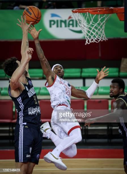 Tony Taylor of Pinar Karsiyaka in action against Josh Bostic of Happy Casa Brindisi during FIBA Champions League play-off Group I match bertween...