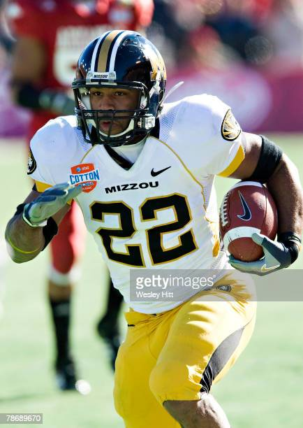 Tony Temple of the Missouri Tigers runs with the ball against the Arkansas Razorbacks at The Cotton Bowl on January 1, 2008 in Dallas, Texas. The...