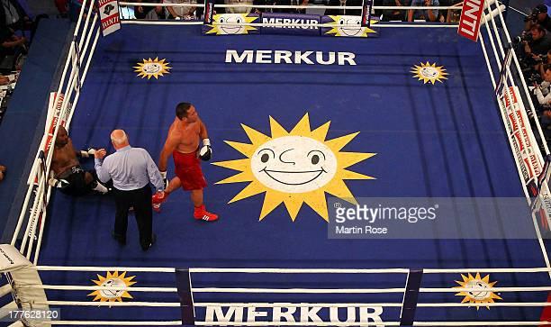 Tony Thompson of USA lies on the flooe during their IBF International heavyweight fight at Sport und Kongresshalle on August 24 2013 in Schwerin...