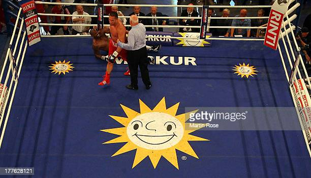 Tony Thompson of USA lies on the flooe during their IBF International heavyweight fight at Sport und Kongresshalle on August 24 2013 in Schwerin...