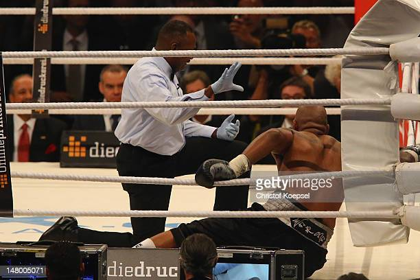 Tony Thompson of USA lies on the ground after being knocked down in the sixth round during the WBA-, IBF,- WBO- and IBO-heavy weight title fight...