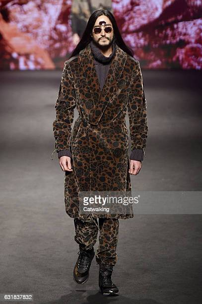 Tony Thornburg walks the runway at the Etro Autumn Winter 2017 fashion show during Milan Menswear Fashion Week on January 16 2017 in Milan Italy