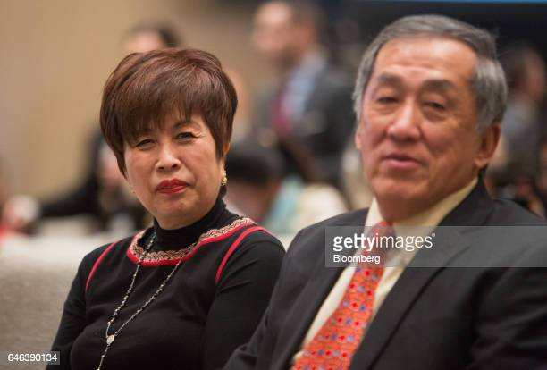 Tony Tiah Thee Kian chairman ofTA Global Bhd and his wife Alicia Tiah sit in the front row during the grand opening ceremony of Trump International...