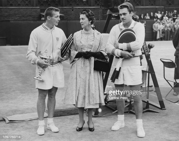 Tony Trabert of the United States holding the Gentlemen's Singles Trophy converses with Princess Marina the Duchess of Kent following his victory...