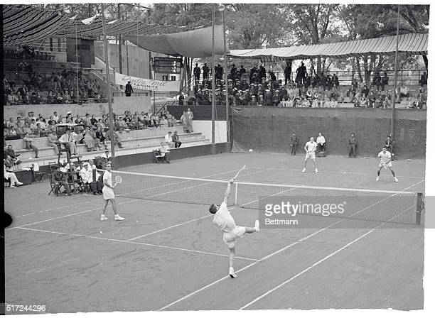 Tony Trabert of the US leaps for a smash back to the Swedish team of Sven DavidsonLennart Bergelin during the final in men's doubles of the...