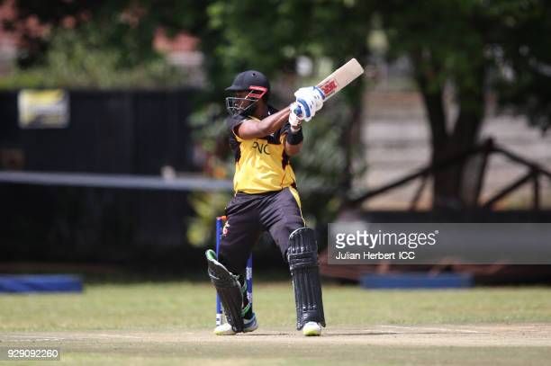Tony Ura of Papua New Guinea scoes runs during The Cricket World Cup Qualifier between The West Indies and Papua New Guinea at The Old Hararians on...