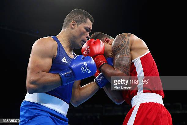 Tony Victor James Yoka of France and Joe Joyce of Great Britain compete during the Men's Super Heavy Final Bout on Day 16 of the Rio 2016 Olympic...
