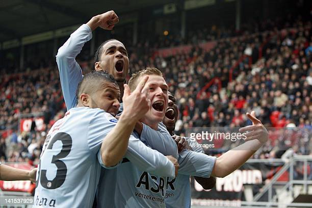 Tony Vilhena and Jerson Cabral John Guidetti of Feyenoord celebrate during the Dutch Eredivisie match between FC Twente and Feyenoord at the Grolsch...