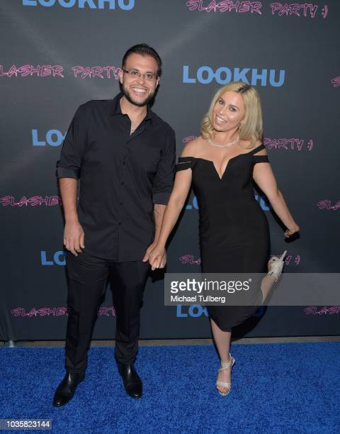 Tony Villalobos and Simona Shyne attend the premiere party for LookHu's Slasher Party at ArcLight Hollywood on September 18 2018 in Hollywood...