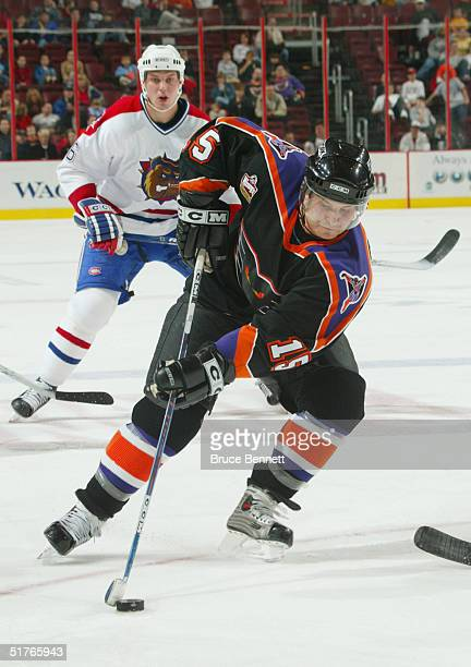 Tony Voce of the Philadelphia Phantoms controls the puck on his backhand against the Hamilton Bulldogs during the American Hockey League game on...