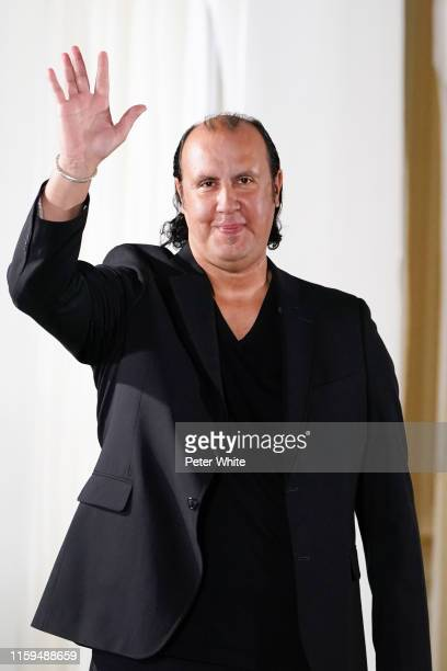 Tony Ward acknowledges the applause of the public after the Tony Ward Haute Couture Fall/Winter 2019 2020 show as part of Paris Fashion Week on July...