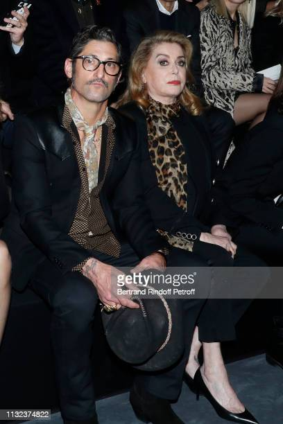 Tony Ward and Catherine Deneuve attend the Saint Laurent show as part of the Paris Fashion Week Womenswear Fall/Winter 2019/2020 on February 26, 2019...