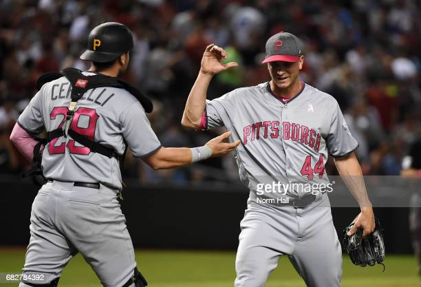 Tony Watson and Francisco Cervelli of the Pittsburgh Pirates celebrate a 43 win against the Arizona Diamondbacks at Chase Field on May 13 2017 in...