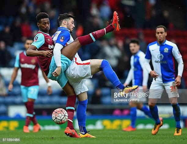 Tony Watt of Blackburn Rovers is challenged by Reece Oxford of West Ham United during The Emirates FA Cup fifth round match between Blackburn Rovers...