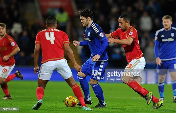 Tony Watt of Cardiff City is tackled by Dexter Blackstock of Nottingham Forest during the Sky Bet Championship match between Cardiff City and...