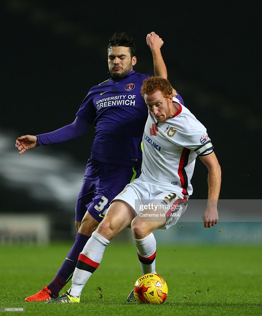 Tony Watt of Charlton Athletic and Dean Lewington of MK Dons during the Sky Bet Championship match between MK Dons and Charlton Athletic at Stadium mk on November 3, 2015 in Milton Keynes, United Kingdom.
