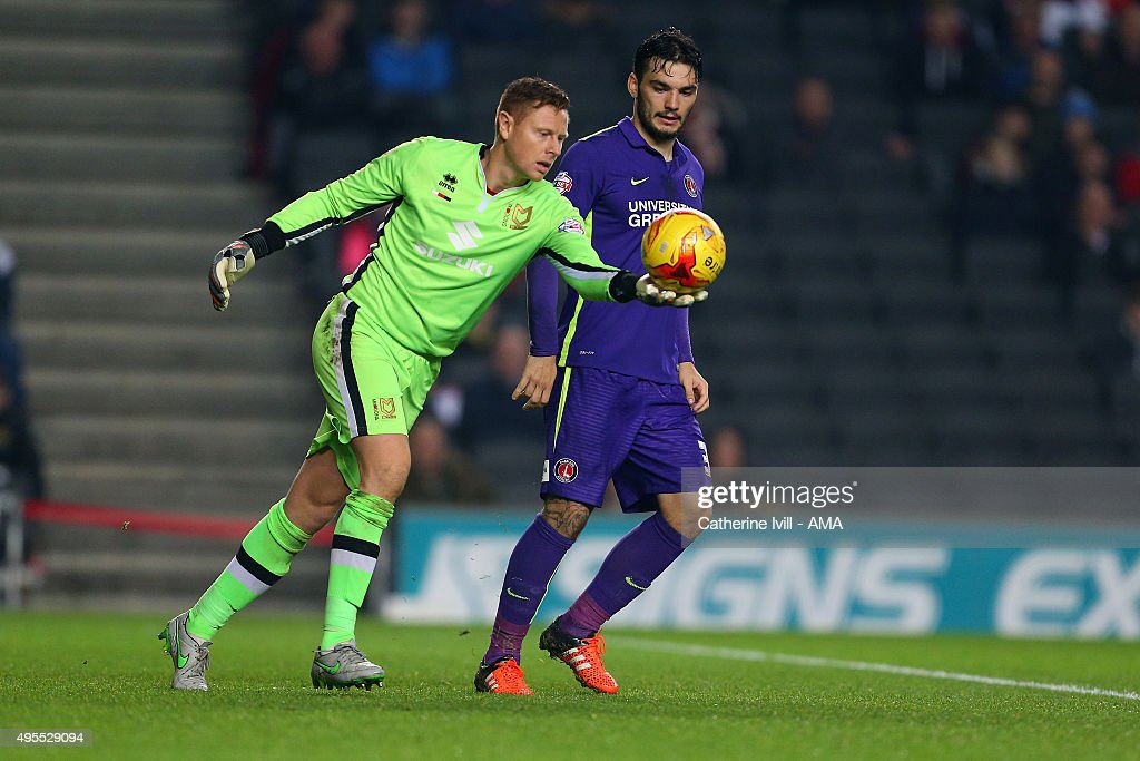 Tony Watt of Charlton Athletic watches as Goalkeeper David Martin of MK Dons takes a goal kick during the Sky Bet Championship match between MK Dons and Charlton Athletic at Stadium mk on November 3, 2015 in Milton Keynes, United Kingdom.